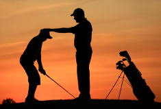 stock-photo-10431310-golf-instructor-with-student-on-the-driving-range